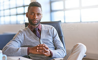 Buy stock photo Portrait of a young businessman sitting at his desk in an office