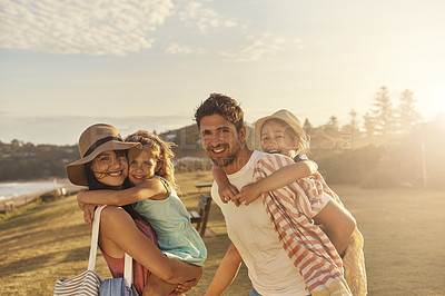 Buy stock photo Shot of a young family at the beach