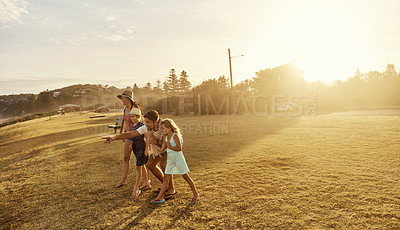 Buy stock photo Shot of a young family spending the day outdoors