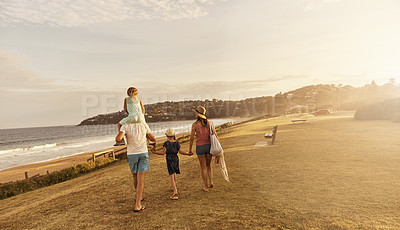 Buy stock photo Shot of a family spending some time together at the beach