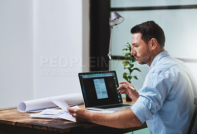 Buy stock photo Cropped shot of a businessman working on his laptop at home