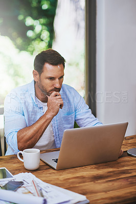 Buy stock photo Cropped shot of a businessman working at home