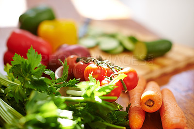 Buy stock photo Shot of fresh vegetables on a kitchen counter