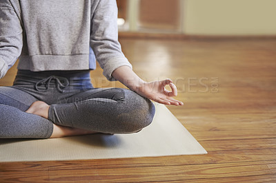 Buy stock photo Cropped shot of a woman meditating indoors