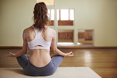 Buy stock photo Rearview shot of a woman meditating indoors