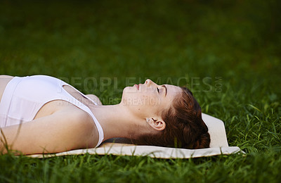 Buy stock photo Cropped shot of a woman lying on her yoga mat