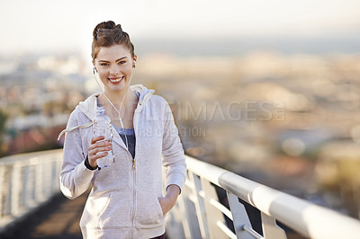 Buy stock photo Cropped portrait of an attractive young woman taking an early morning jog