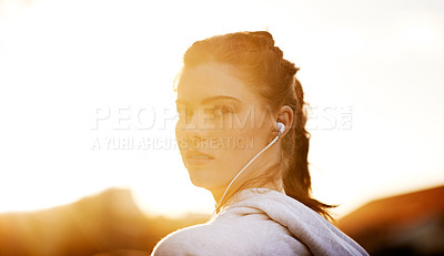 Buy stock photo Rearview portrait of an attractive young woman taking an early morning jog