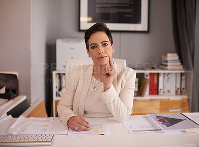 Buy stock photo Cropped portrait of a mature businesswoman sitting in her office