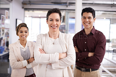 Buy stock photo Cropped portrait of three businesspeople standing with their arms folded