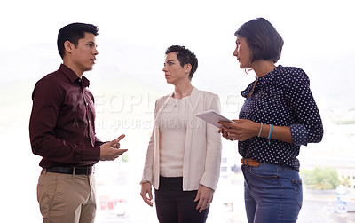Buy stock photo Cropped shot of three businesspeople talking in the hallway