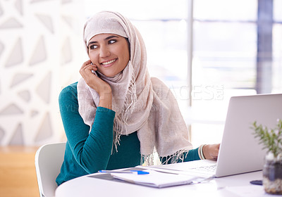 Buy stock photo Shot of a young businesswoman using a mobile phone in an office