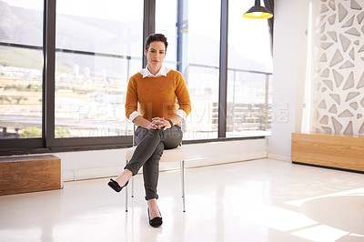Buy stock photo Portrait of a businesswoman sitting on a chair in an office