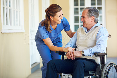 Buy stock photo Shot of a doctor caring for her senior patient at a nursing home