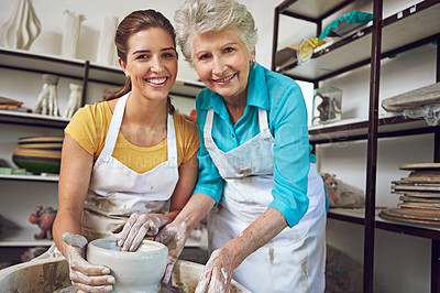 Buy stock photo Portrait of a mother and daughter making a ceramic pot together in a workshop