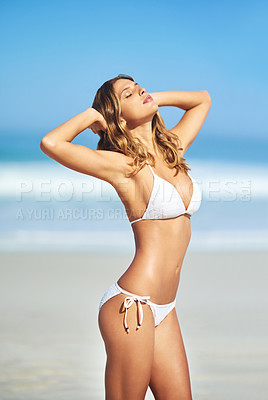 Buy stock photo Shot of a gorgeous young woman in a bikini at the beach