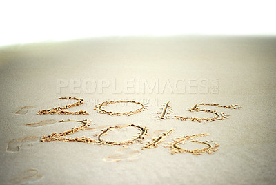 Buy stock photo Shot of the years 2015 and 2016 written in sand