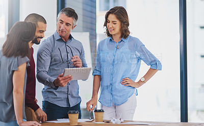 Buy stock photo Cropped shot of a group of businesspeople working in the office