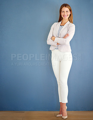Buy stock photo Shot of a woman dressed in office-wear posing against a blue background