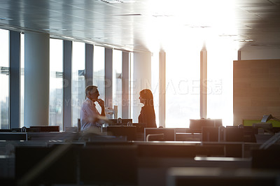 Buy stock photo Shot of two businesspeople talking in the office