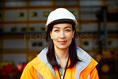 Buy stock photo Portrait of a woman in workwear standing on a commercial dock