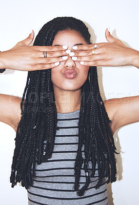 Buy stock photo Studio shot of an attractive young woman covering her eyes