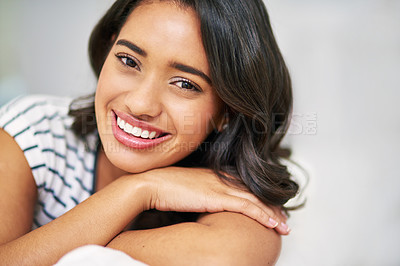 Buy stock photo Cropped portrait of a young woman relaxing at home on the weekend