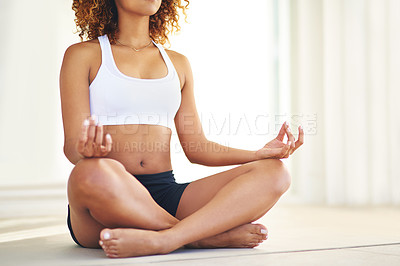 Buy stock photo Cropped shot of a young woman practising her yoga routine