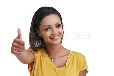 Buy stock photo Studio shot of a young woman giving a thumbs up against a white background
