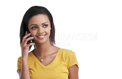 Buy stock photo Studio shot of a young woman speaking on a cellphone against a white background