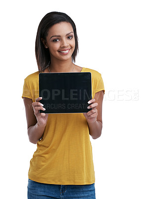 Buy stock photo Studio portrait of a young woman holding a digital tablet with a blank screen against a white background