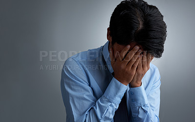 Buy stock photo Studio shot of a businessman having a breakdown against a gray background