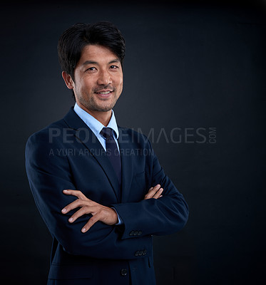 Buy stock photo Studio shot of a businessman against a dark background