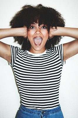 Buy stock photo Studio shot of an excited young woman posing against a gray background