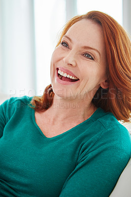 Buy stock photo Cropped shot of a mature woman relaxing on the sofa at home