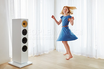 Buy stock photo Full length shot of a little girl dancing at home