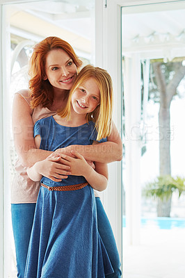 Buy stock photo Cropped shot of a mature woman hugging her young daughter at home