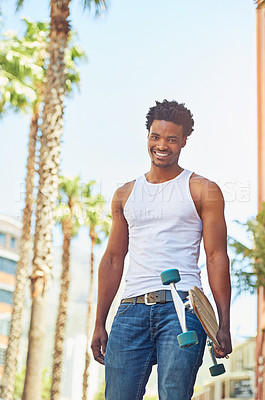 Buy stock photo Portrait of a young skater in the city