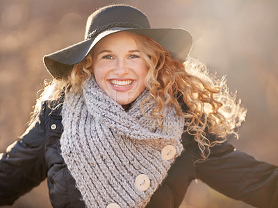Buy stock photo Shot of a young woman enjoying a walk outdoors in winter