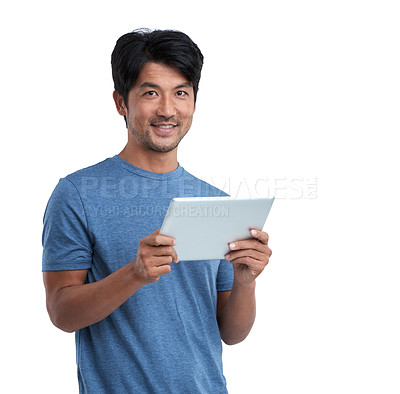 Buy stock photo Studio shot of a man using a digital tablet against a white background