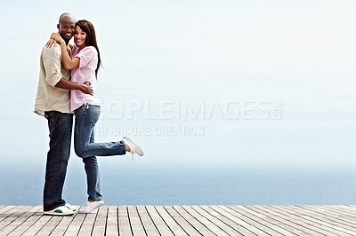 Buy stock photo Full length portrait of an affectionate couple enjoying a day outside together