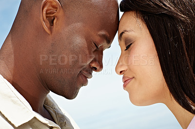 Buy stock photo Cropped shot of an affectionate couple enjoying a day outside together