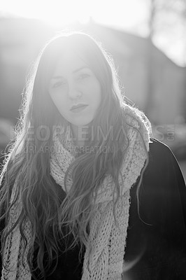 Buy stock photo Black and white portrait of a young woman standing outdoors