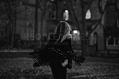 Buy stock photo Black and white shot of a young woman outdoors