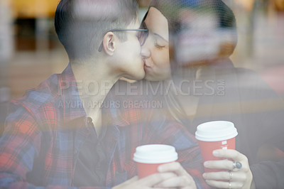 Buy stock photo Shot of a young couple on a coffee date at a cafe