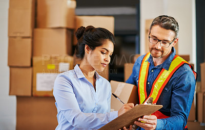 Buy stock photo Cropped shot of a male warehouse worker and his female boss
