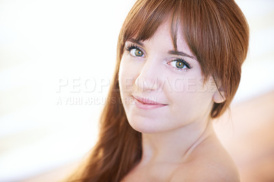 Buy stock photo Portrait of a beautiful young woman posing indoors