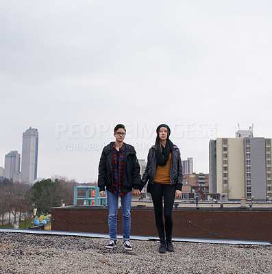 Buy stock photo Shot of an affectionate couple standing against a city background