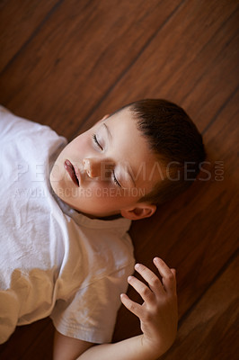 Buy stock photo Shot of a little boy playing on the floor