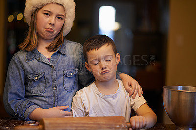 Buy stock photo Shot of a playful brother and sister baking at home during Christmas